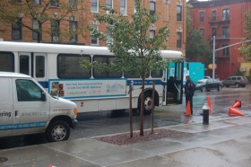 A bus transporting residents from a Zone A in Coney Island arrives at the John Jay school evacuation center.