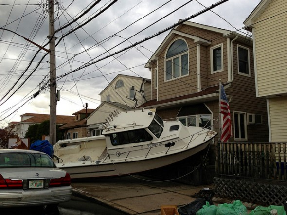 Boat washed into house in Broad Channel