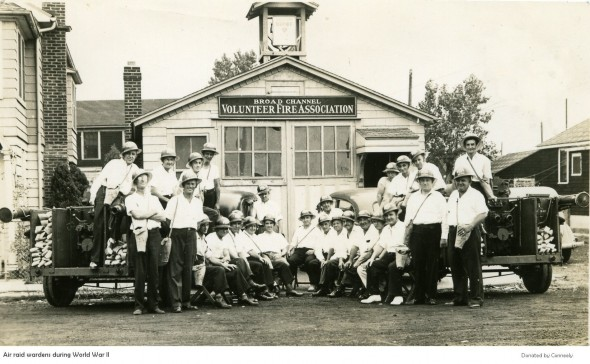 World War II air raid wardens in Broad Channel, Queens, in front of volunteer firehouse.