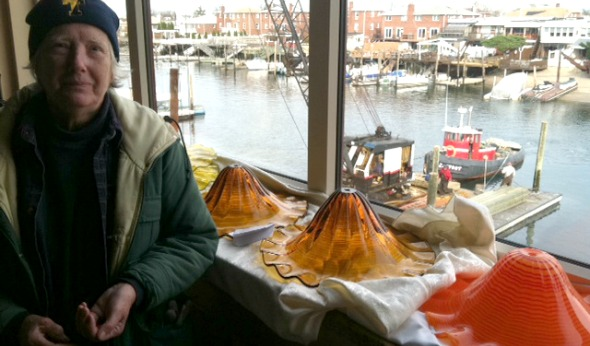 "Barbara Toborg at Vetro Restaurant on Cross Bay Boulevard, which gave the Broad Channel Historical Society space to dry out its wet collection. In the background is the canal the tugboat called ""Little Toot,"" which was made famous in a 1940s children's story."
