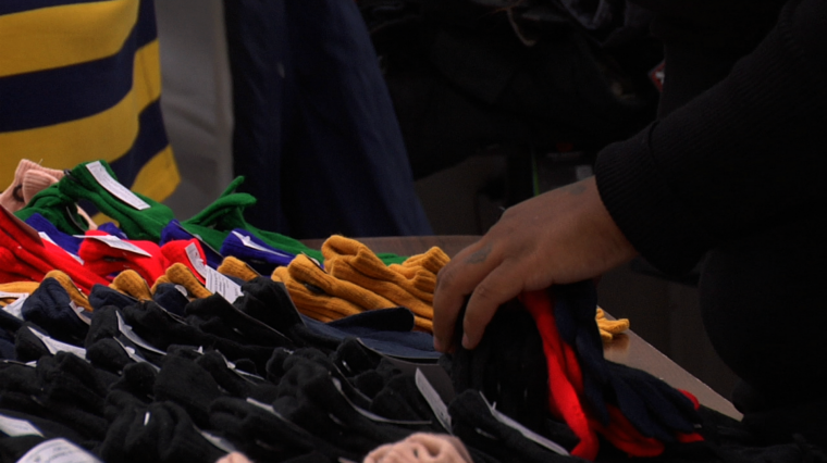 Retired Glove Manufacturer Gives Helping Hand to Those in Need