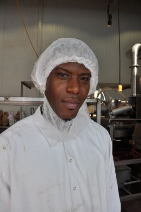 Young man in white shirt and white hairnet