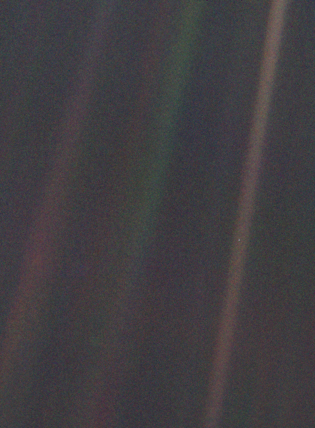 As Voyager 1 traveled into the outer reaches of our Solar System, it turned around and photographed Earth