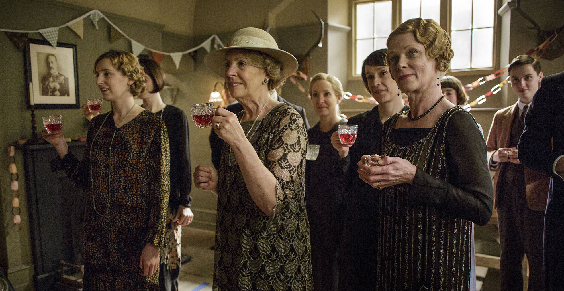 A scene from Downton Abbey, Season 6, Episode 4 on MASTERPIECE on PBS. L to R: Laura Carmichael as Lady Edith, Penelope Wilton as Isobel Crawley, Joanne Froggatt as Anna Bates, Raquel Cassidy as Baxter, and Samantha Bond as Aunt Rosamund