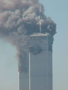THIRTEEN's broadcast antenna on the North Tower of the World Trade Center, seen through the smoke on 9/11. Photo by WNET/Thirteen, taken from its headquarters on West 33rd Street in New York City.