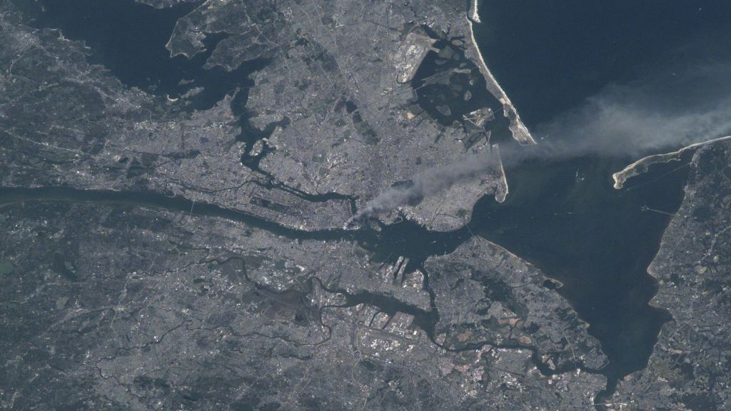 A satellite image of the smoke plume from Ground Zero in Lower Manhattan. Photo by NASA.