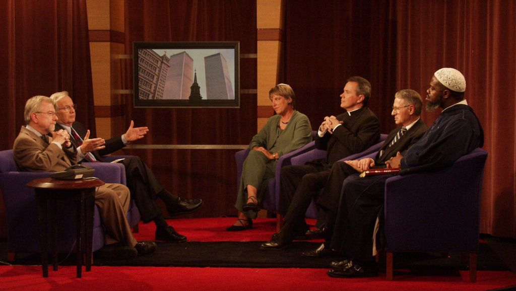 Host Bill Moyers and WNET/Thirteen President and CEO Bill Baker with guests on an episode of New York Voices: The Day After, produced by Thirteen in the weeks after 9/11. Photo: WNET/Thirteen