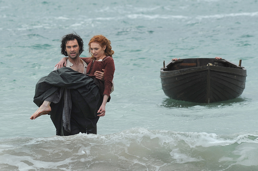Poldark, Season 2 MASTERPIECE on PBS Episode Three | Sunday, October 16th at 9pm ET on PBS | Smugglers make Ross an offer. Ross makes Francis an offer. Verity reappears. Ross and George engage in a frank discussion. Demelza risks her neck before a blessed event. Shown, from left to right: Aidan Turner as Ross and Eleanor Tomlinson as Demelza (C) Mammoth Screen for BBC and MASTERPIECE