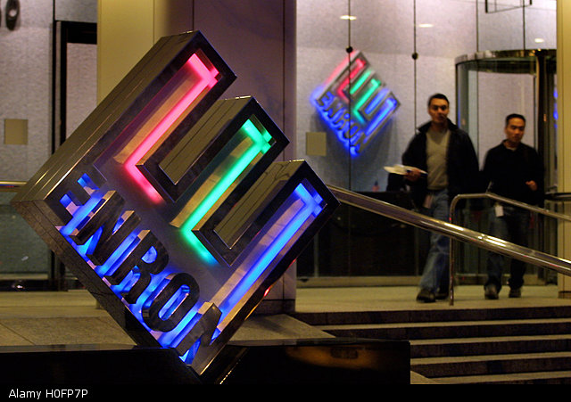 Enron employees leave the headquarters building in Houston, TX, late February 7, 2002. REUTERS/Richard Carson RJC.