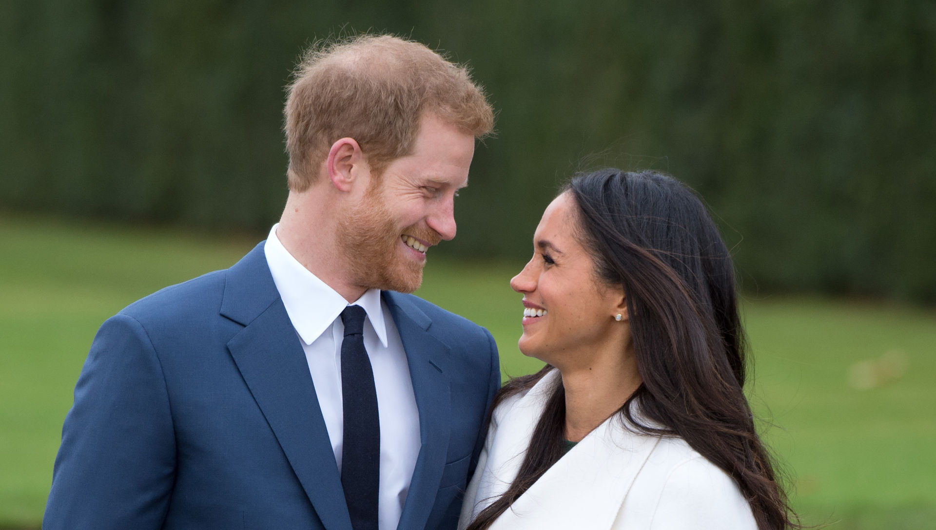 Prince Harry and Meghan Markle, in the Sunken Gardens at Kensington Palace following the announcement of their engagement