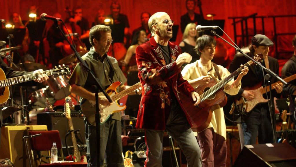 (L to R): Eric Clapton, Ringo Starr, Dhani Harrison, Marc Mann in Concert for George.