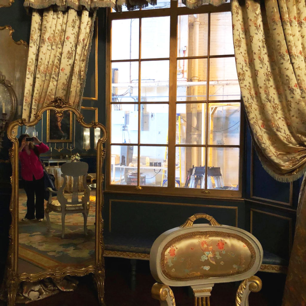 A view out the window of Victoria's bedroom on the set, plus a glimpse of Deborah Gilbert.