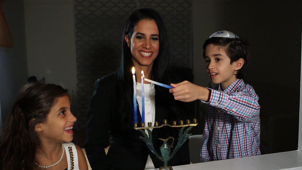 Inbar Algov Kaplan and children in Hanukkah: Festival of Delights.
