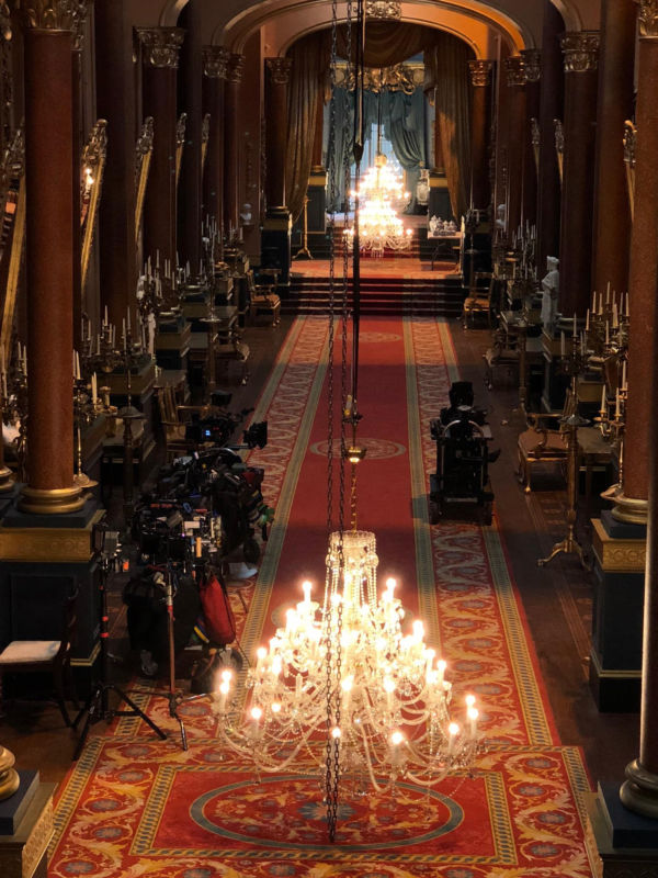 The chandeliers and equipment that make magic in the Buckingham Palace hallway set. Photo: Deborah Gilbert
