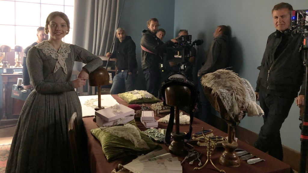 Actress Nell Hudson (Mrs. Skerrett) getting ready to shoot a scene.