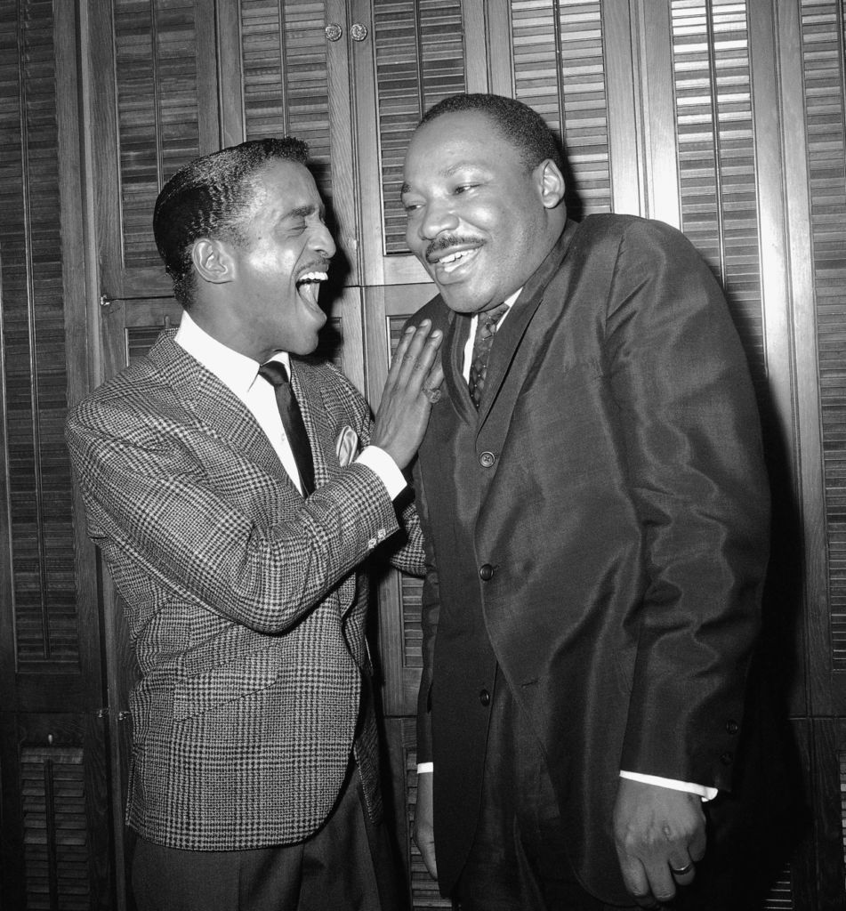 Sammy Davis, Jr. and Dr. Martin Luther King laughing together backstage at the Majestic Theater in 1965