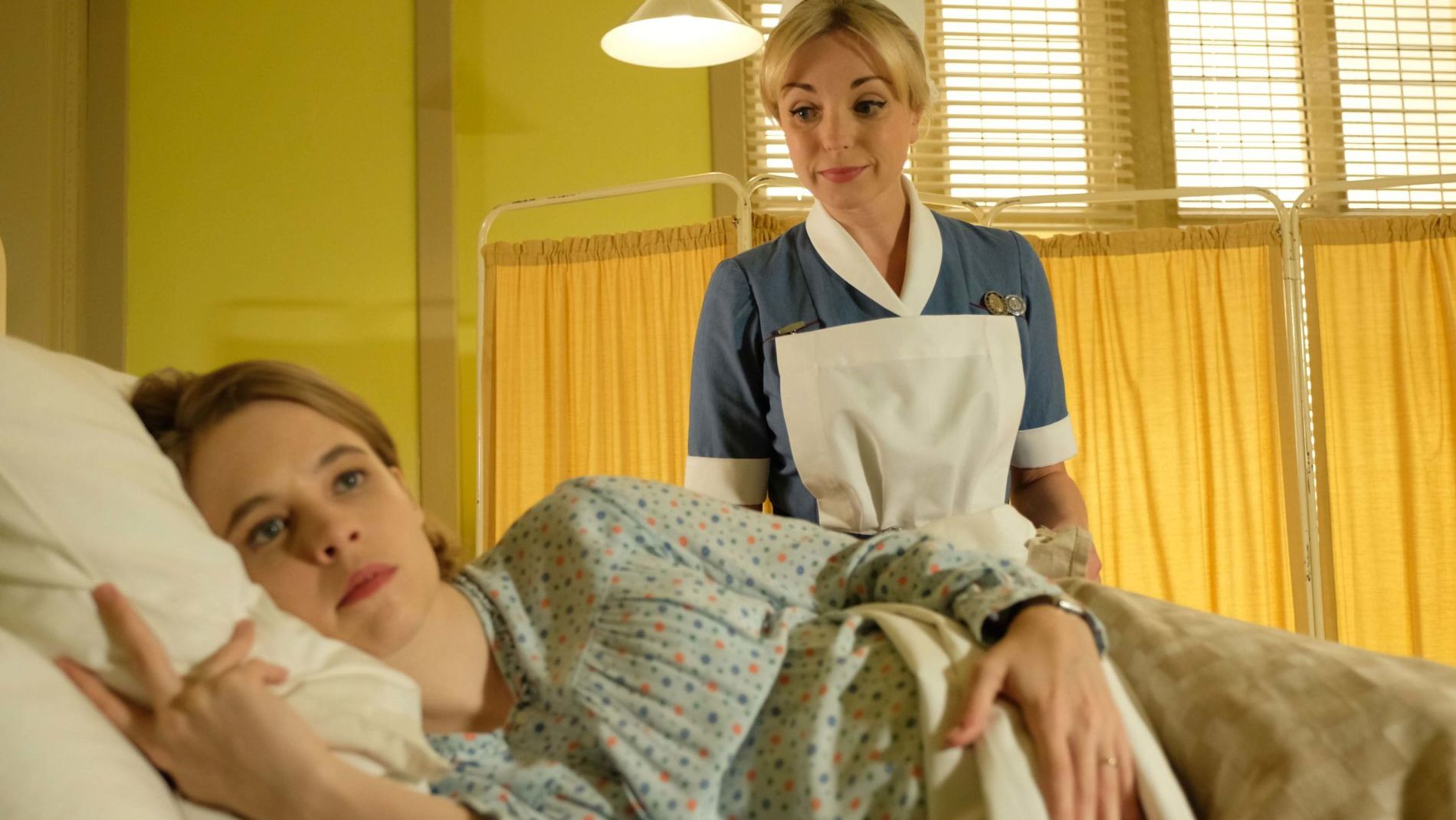 Nurse Trixie Franklin (Helen George) helps the pregnant Mrs. Lombardi (Jessica Clark).