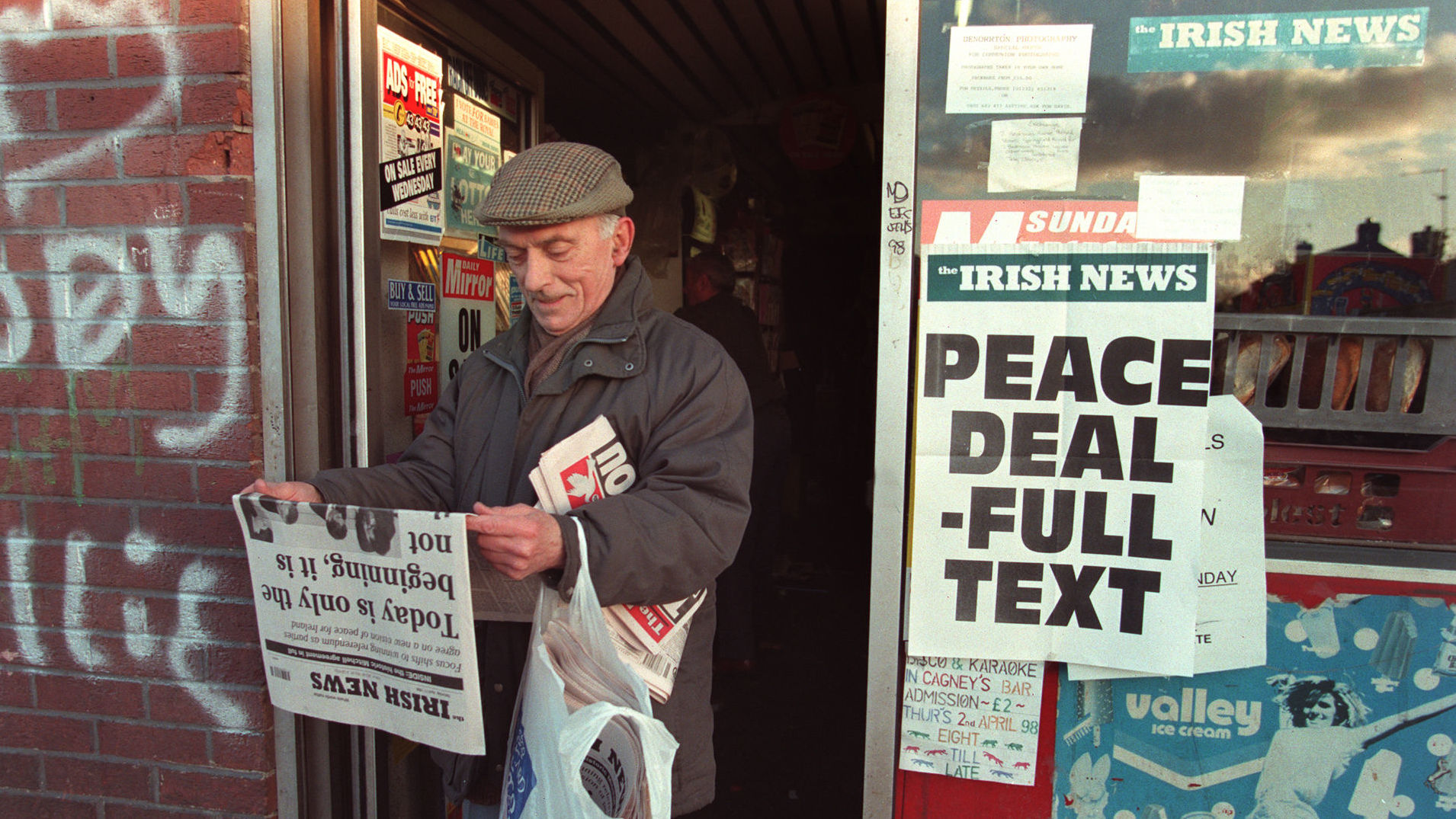 Belfast resident opening paper upon announcement of the Good Friday Agreement, April 1998.