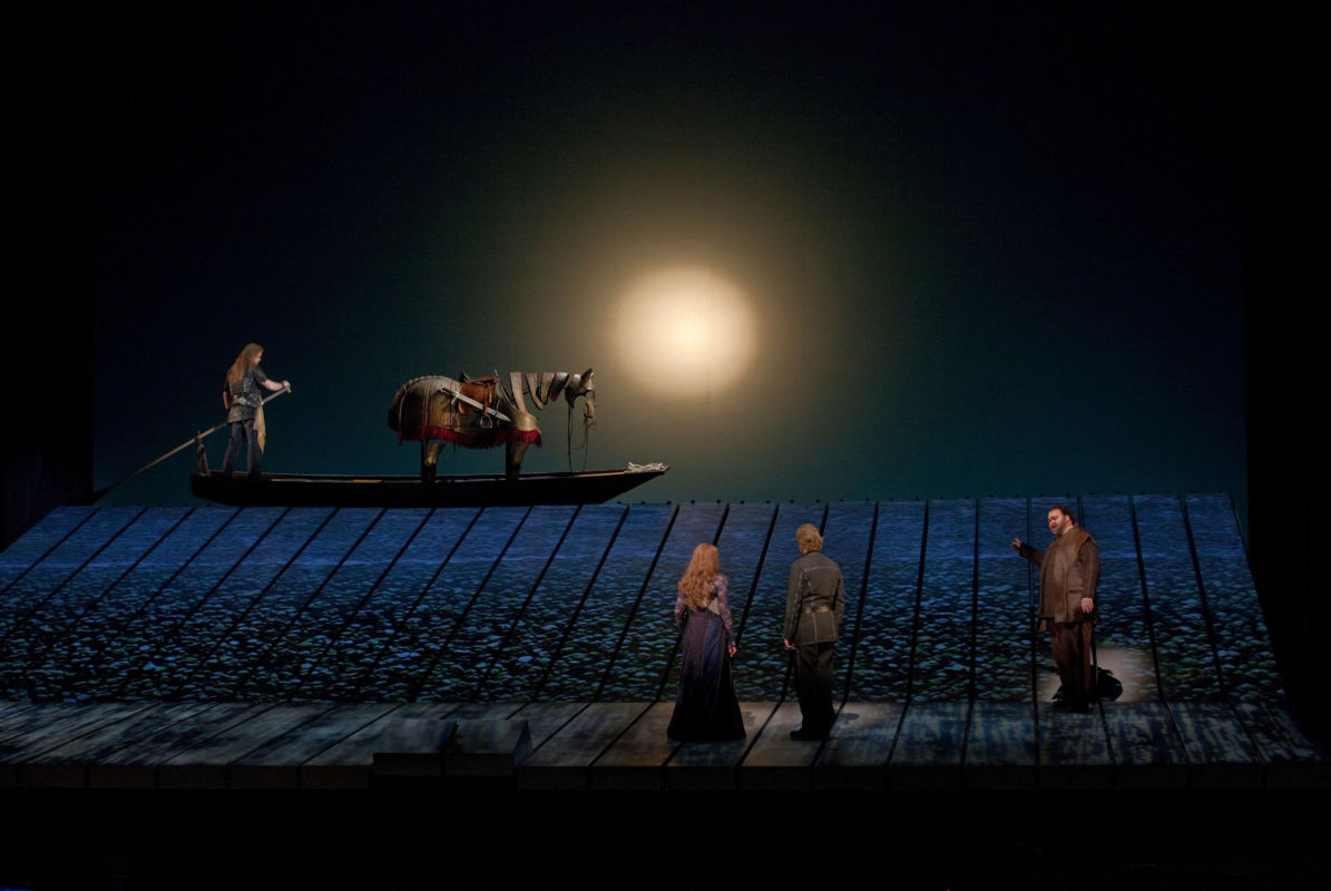 A scene from Wagner's Götterdämmerung with Jay Hunter Morris (on boat) as Siegfried, Wendy Bryn Harmer as Gutrune, Iain Paterson as Gunther, and Hans-Peter König as Hagen.