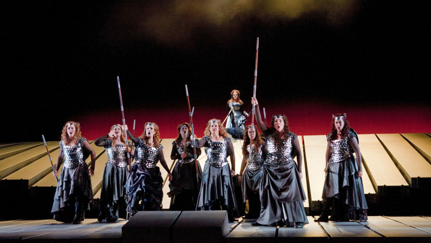 A scene from Act 3 of Wagner's Die Walküre with the Valkuries (left to right): Marjorie Elinor Dix as Waltraute, Wendy Bryn Harmer as Ortlinde, Molly Fillmore as Helmwige, Kelly Cae Hogan as Gerhilde, Mary Ann McCormick as Grimgerde, Lindsay Ammann as Rossweisse, Eve Gigliotti as Siegrune, and Mary Phillips as Schwertleite. At top is Deborah Voigt as Brünnhilde.