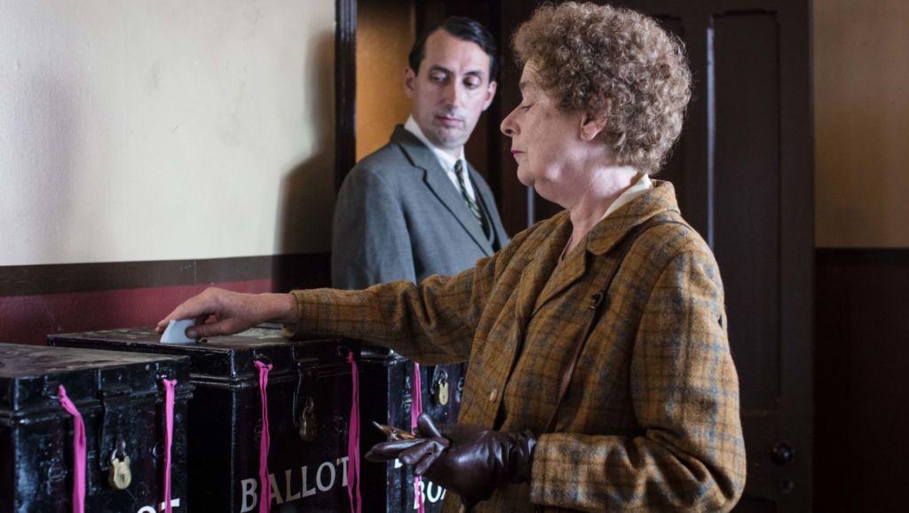 Nurse Phyllis Crane (LINDA BASSETT) casts her vote.