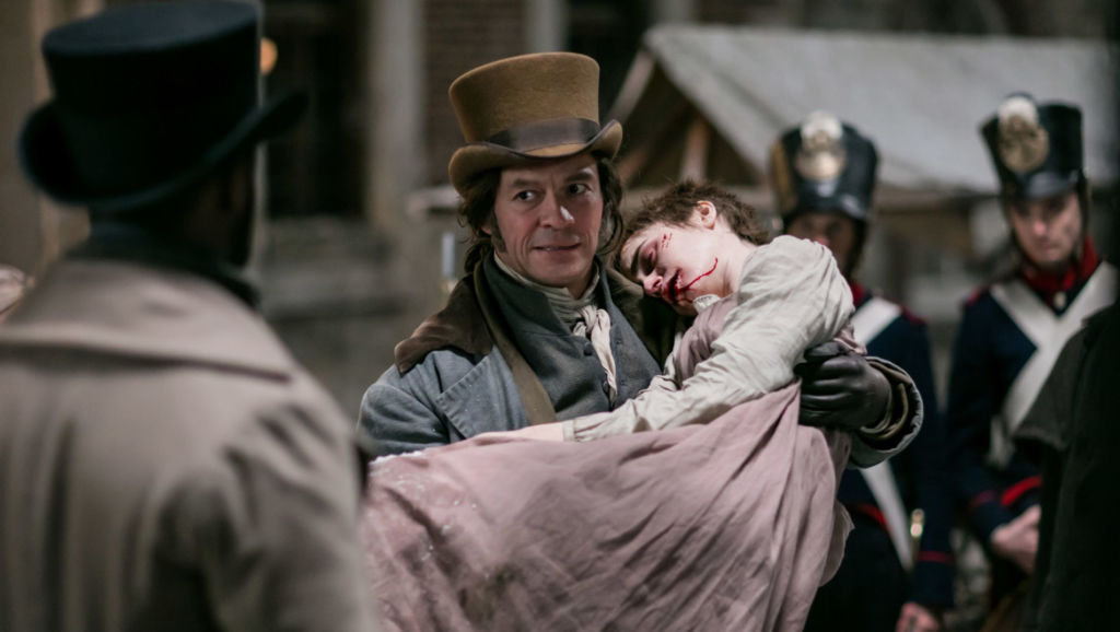 Episode 2. L to r: Javert (DAVID OYELOWO) and Jean Valjean (DOMINIC WEST) with the assumed name of Monsieur Madeleine argue over the fate of an ill Fantine (LILY COLLINS). Photo: Laurence Cendrowicz (C) Lookout Point