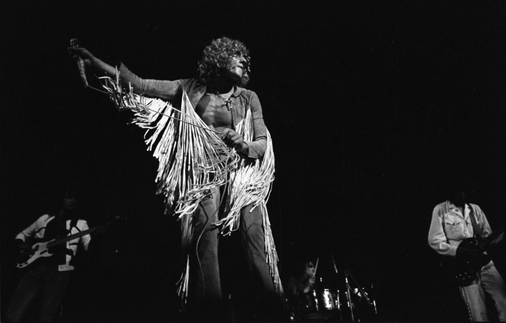 Roger Daltrey from The Who performing on stage at the Woodstock Festival, 1969.