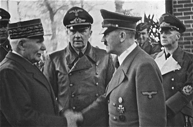 Adolf Hitler greets the Vichy leader Philippe Pétain (at left) in Montoire-sur-le-Loir. In center: Interpeter Dr. Paul Schmidt. At right: Nazi Foreign Minister Joachim von Ribbentrop.