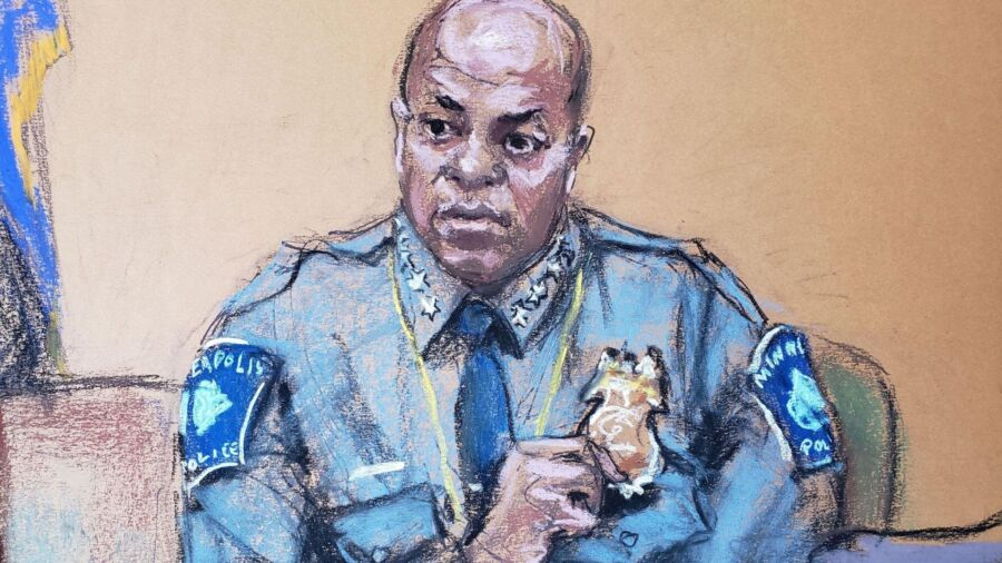 A pastel illustration of bald, Black police officer in blue uniform dress shirt, wearing gold badge. He is seated in witness box in court.
