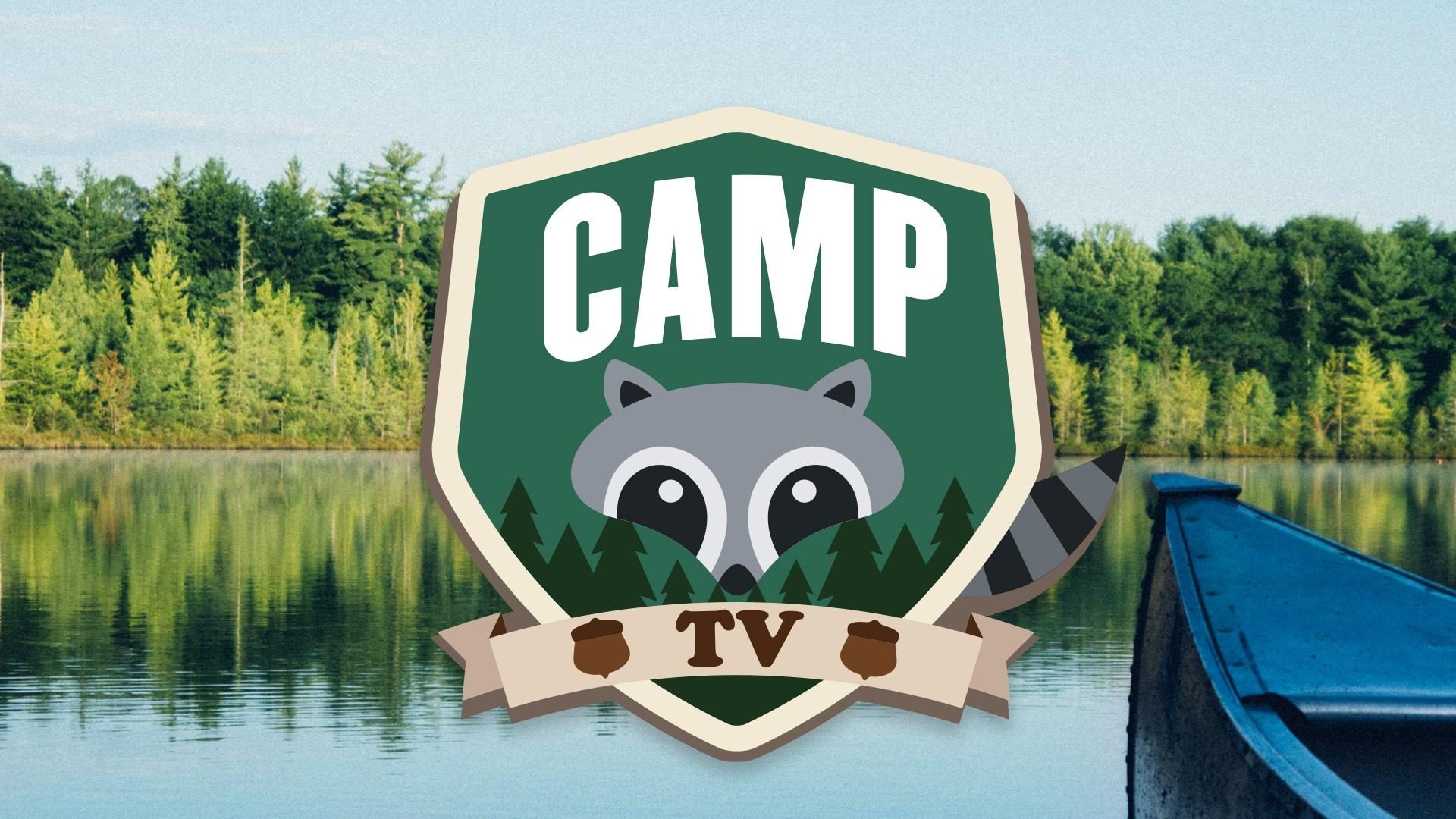 A graphic image of green badge with Camp TV written onit and cartoon image of racoon face. It is superimposed over photo of lake with greenery on shore and the tip of boat in foreground.