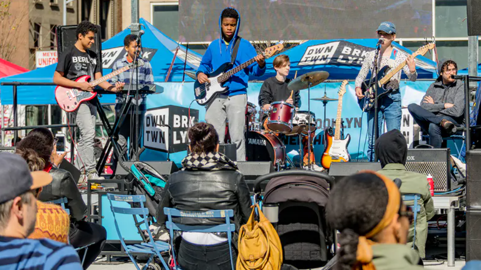 Kids from the Brooklyn Music School performing on a stage