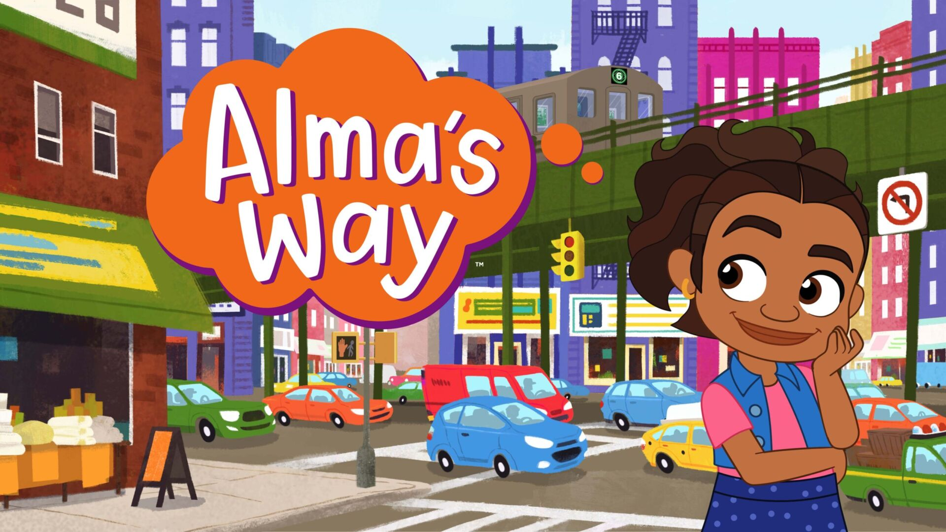A brown-skinned girl stands at New York City intersection. There is a grocery store across the street, cars driving and and elevated train track and high-rise buildings in background.